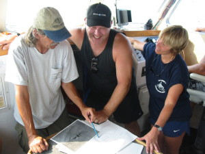 With archaeologist Jeff Johnston (NOAA) and diver Shelly Johnson examining USS Monitor illustrations.